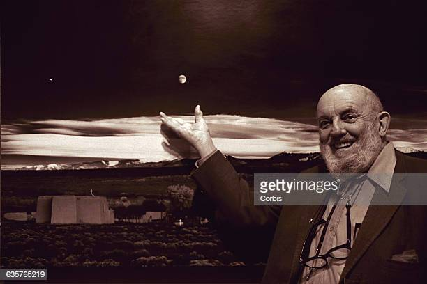 Ansel Adams at a party celebrating the fortieth anniversary of his photograph 'Moonrise Over Hernandez NM' He stands next to a large print of the...