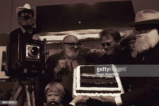 Ansel Adams at a party celebrating the fortieth anniversary of his photograph 'Moonrise Over Hernandez NM' A cake is decorated with the photo and...