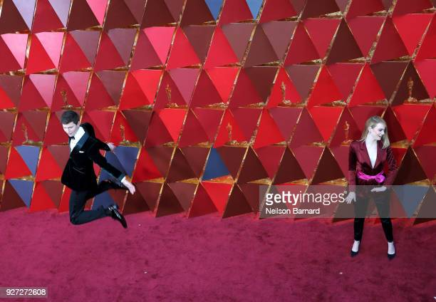 Ansel Elgort and Emma Stone attend the 90th Annual Academy Awards at Hollywood Highland Center on March 4 2018 in Hollywood California