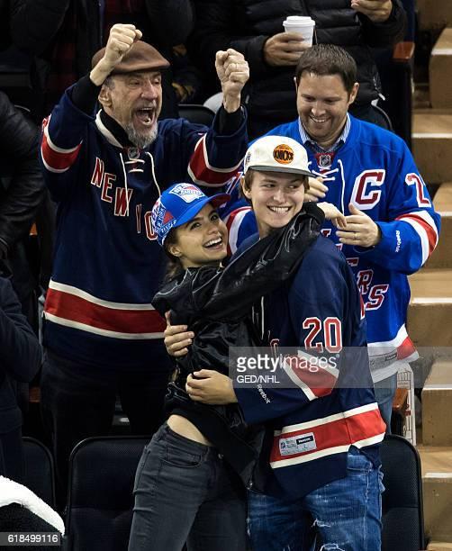 Ansel Elgort and girlfriend Violetta Komyshan attends Boston Bruins Vs New York Rangers game at Madison Square Garden on October 26 2016 in New York...