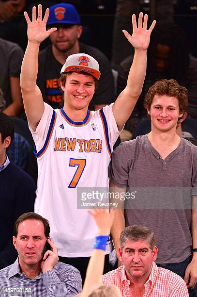 Ansel Elgort and guest attend the Miami Heat vs New York Knicks game at Madison Square Garden on November 30 2014 in New York City