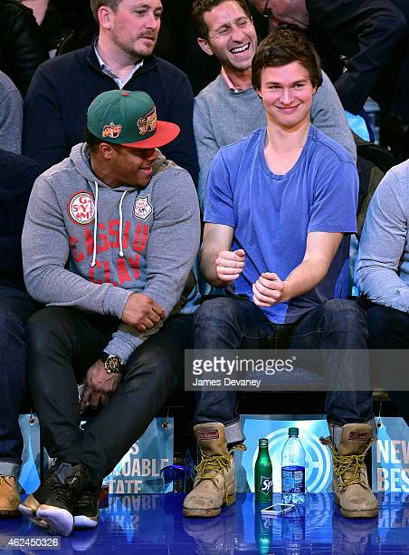 Ansel Elgort and guest attend the Oklahoma City Thunder vs New York Knicks game at Madison Square Garden on January 28 2015 in New York City