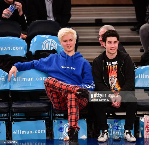 Ansel Elgort and guest attend the Phoenix Suns v New York Knicks game at Madison Square Garden on December 17 2018 in New York City