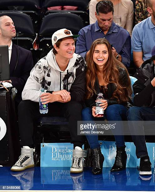 Ansel Elgort and Violetta Komyshan attend New York Knicks vs Brooklyn Nets preseason game at Madison Square Garden on October 8 2016 in New York City