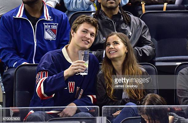 Ansel Elgort and Violetta Komyshan attend the Pittsburgh Penguins vs New York Rangers playoff game at Madison Square Garden on April 16 2015 in New...