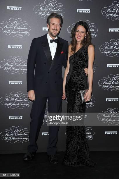 Anselmo Guerrieri Gonzaga and Ilaria Tronchetti Provera attend The Pirelli Calendar 50th Anniversary Red Carpet on November 21 2013 in Milan Italy