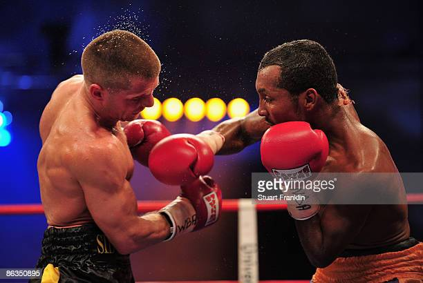 Anselmo Moreno of Panama throws a punch against Wladimir Sidorenko of Ukraine during the WBA World Championship bantamweight fight a the Universum...