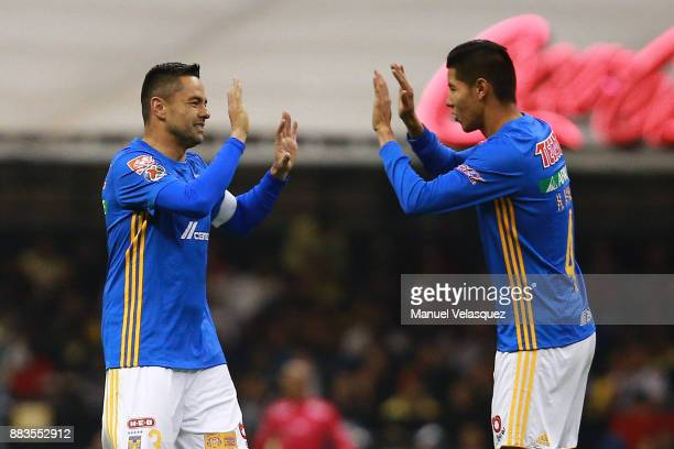 Anselmo Vendrechovski and Hugo Ayala of Tigres celebrate the first goal of their team during the semifinal first leg match between America and Tigres...