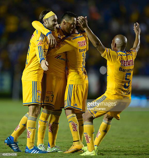 Anselmo Vendrechovski 'Juninho' of Tigres celebrates with teammates after scoring his team's first goal during a match between Tigres UANL v...