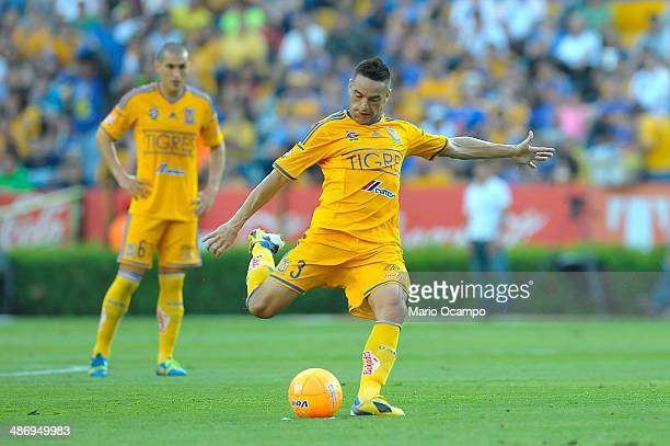 Anselmo Vendrechovsky Juninho of Tigres takes a free kick during a match between Tigres UANL and Atlas as part of 17th round Clausura 2014 Liga MX at...