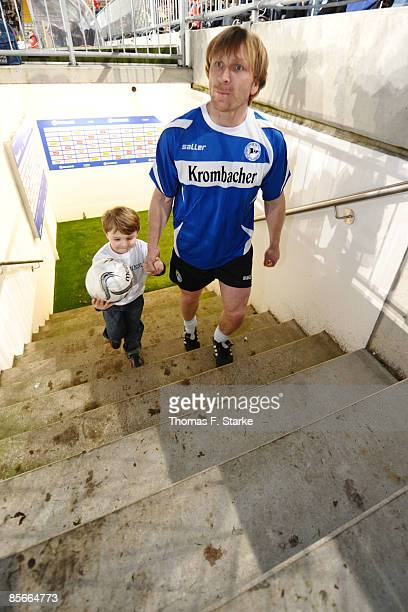 Ansgar Brinkmann enters the pitch with his nephew during the Ansgar Brinkmann Farewell Match at the Schueco Arena on March 27 2009 in Bielefeld...