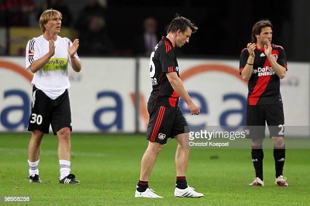 Ansgar Brinkmann of Schnix All Stars and Gonzalo Castro of Leverkusen applaud Bernd Schneider of Leverkusen after the Bernd Schneider farewell match...