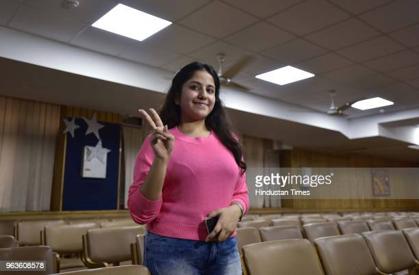 Anshika Gupta student of Amity International school pose for a photograph who scored 498 marks out of 500 in CBSE class 10th boards and was declared...