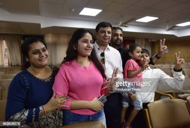 Anshika Gupta student of Amity International school pose for a photograph with family members who scored 498 marks out of 500 in CBSE class 10th...