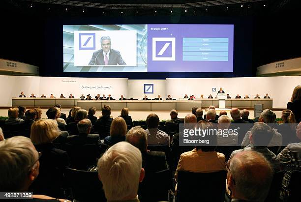 Anshu Jain cochief executive officer of Deutsche Bank AG is seen on a large screen as he speaks during the bank's annual general meeting in Frankfurt...