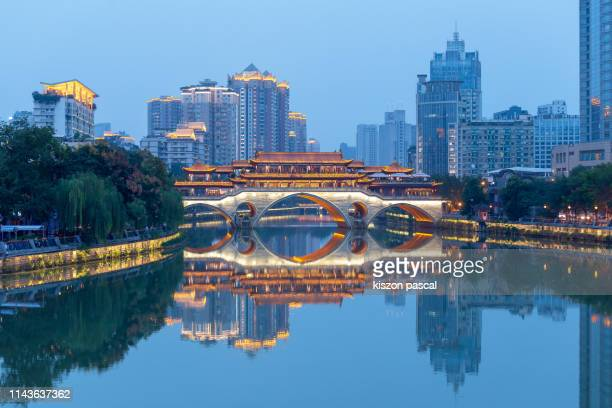 anshun bridge in chengdu illuminated at night , sichuan province , china . - south china stock pictures, royalty-free photos & images