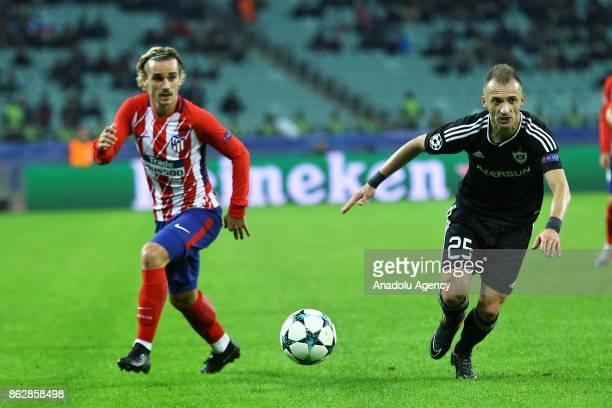 Ansi Agolli of Qarabag Agdam in action against Antoine Griezmann of Atletico Madrid during the UEFA Champions League Group C soccer match between...
