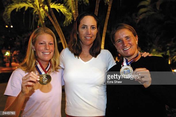 Ansley Cargill winner of the singles bronze medal Coach Debbie Graham and Sarah Taylor winner of the singles silver medal pose with their medals on...