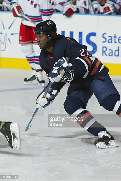 Anson Carter of the Edmonton Oilers skates on the ice during an NHL game against the New York Rangers circa 2003 at the Madison Square Garden in New...