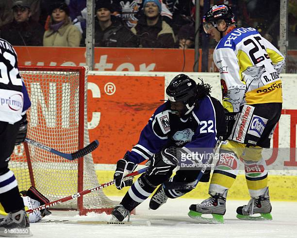 Anson Carter of the Primus Worldstars is taken down by Rolf Zeigler of SC Bern on December 15, 2004 at Bern Arena in Bern, Switzerland.