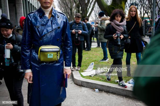 Anson Lau wearing blue trench is seen outside Giorgio Armani show during Milan Fashion Week Fall/Winter 2018/19 on February 24 2018 in Milan Italy