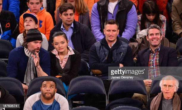 Anson Mount and Andy Cohen attend the San Antonio Spurs vs New York Knicks game at Madison Square Garden on November 10 2013 in New York City