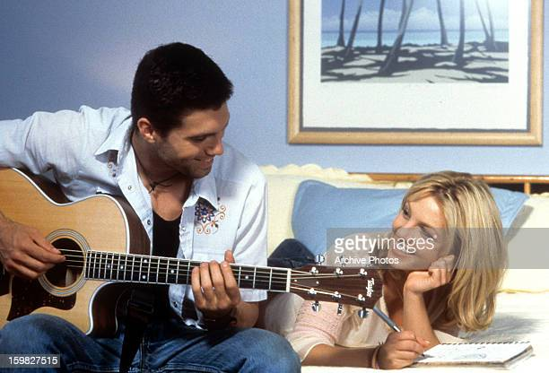 Anson Mount playing guitar for Britney Spears in a scene from the film 'Crossroads' 2002