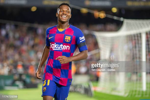 Anssumane Fati of Barcelona celebrates after providing the assist for his sides second goal by Frenkie de Jong of Barcelona and becoming the youngest...