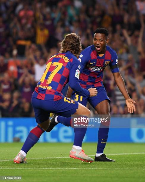 Anssumane Fati of Barcelona celebrates after scoring his team's first goal with Antoine Griezmann during the Liga match between FC Barcelona and...
