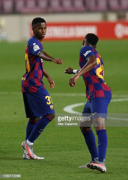 Anssumane Fati of Barcelona celebrates with Junior Firpo of Barcelona after he scores his teams first goal during the Liga match between FC Barcelona...