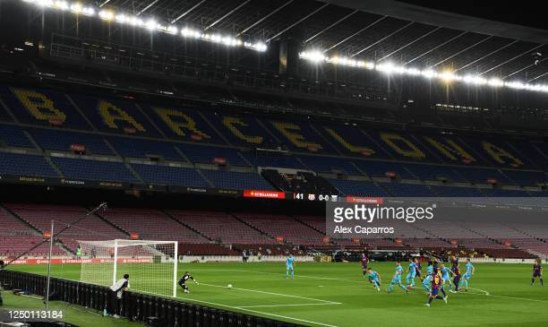 Anssumane Fati of Barcelona scores his teams first goal during the Liga match between FC Barcelona and CD Leganes at Camp Nou on June 16, 2020 in...