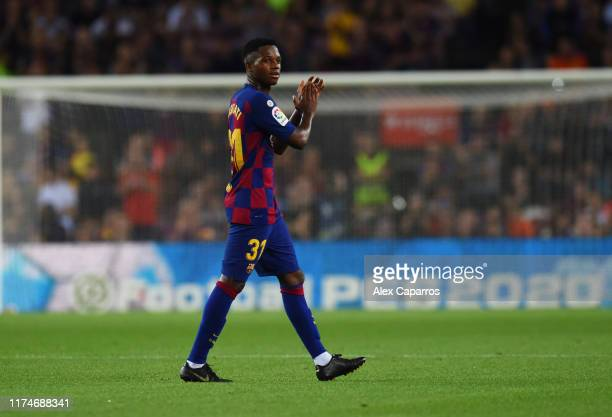 Anssumane Fati of FC Barcelona acknowledges the fans as he is substituted during the Liga match between FC Barcelona and Valencia CF at Camp Nou on...