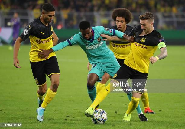 Anssumane Fati of FC Barcelona battles with Achraf Hakimi Axel Witsel and Marco Reus of Borussia Dortmund during the UEFA Champions League group F...