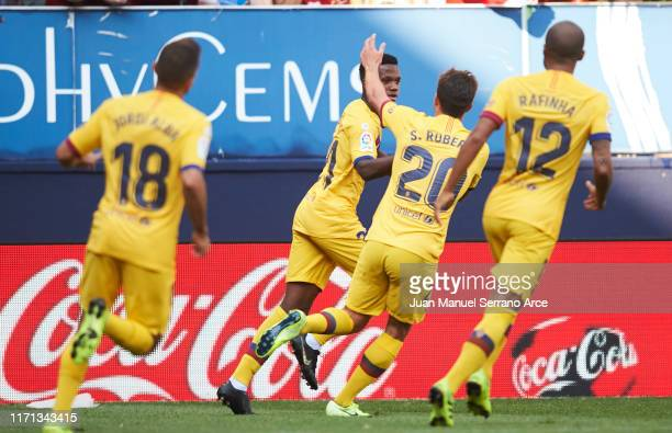 Anssumane Fati of FC Barcelona celebrates after scoring the first goal of his team during the Liga match between CA Osasuna and FC Barcelona at...
