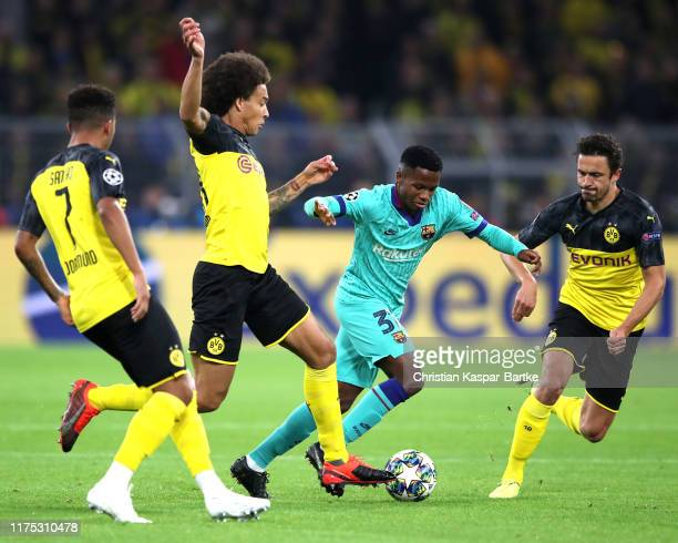 Anssumane Fati of FC Barcelona evades Axel Witsel of Borussia Dortmund during the UEFA Champions League group F match between Borussia Dortmund and...