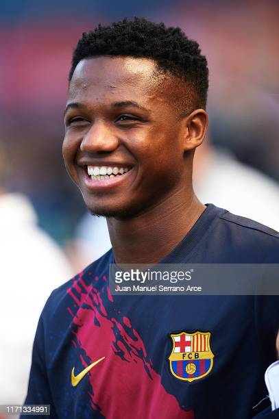 Anssumane Fati of FC Barcelona smiles during the warm up prior to the Liga match between CA Osasuna and FC Barcelona at Estadio El Sadar on August 31...