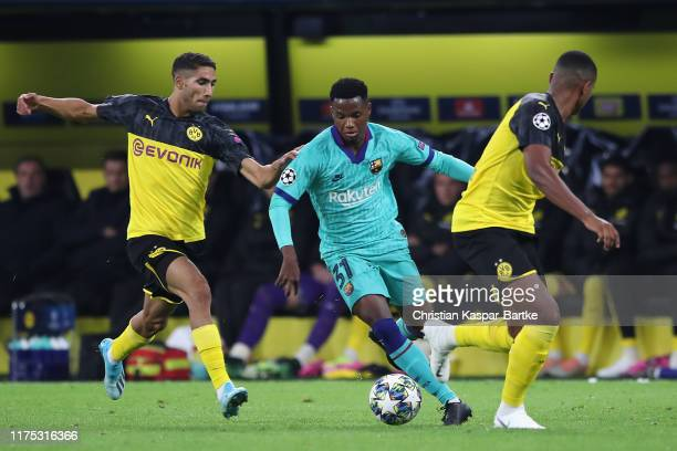 Anssumane Fati of FC Barcelona takes on Achraf Hakimi and Manuel Akanji of Borussia Dortmund during the UEFA Champions League group F match between...