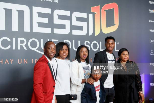 Ansu Fati and his family pose on the red carpet during the premiere of 'Messi 10' by Cirque du Soleil on October 10 2019 in Barcelona Spain