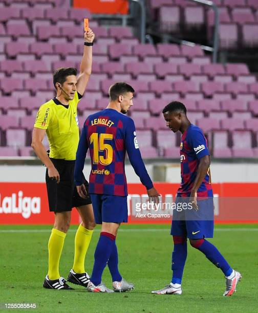 Ansu Fati FC Barcelona is shown a red car by the referee during the Liga match between FC Barcelona and RCD Espanyol at Camp Nou on July 08 2020 in...
