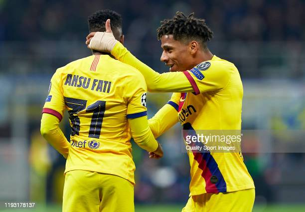 Ansu Fati of Barcelona celebrates after scoring his team's second goal with his teammate Jean-Clair Todibo during the UEFA Champions League group F...
