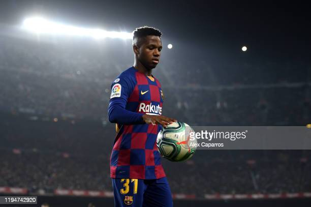 Ansu Fati of Barcelona gathers the ball during the Liga match between FC Barcelona and Real Madrid CF at Camp Nou on December 18 2019 in Barcelona...