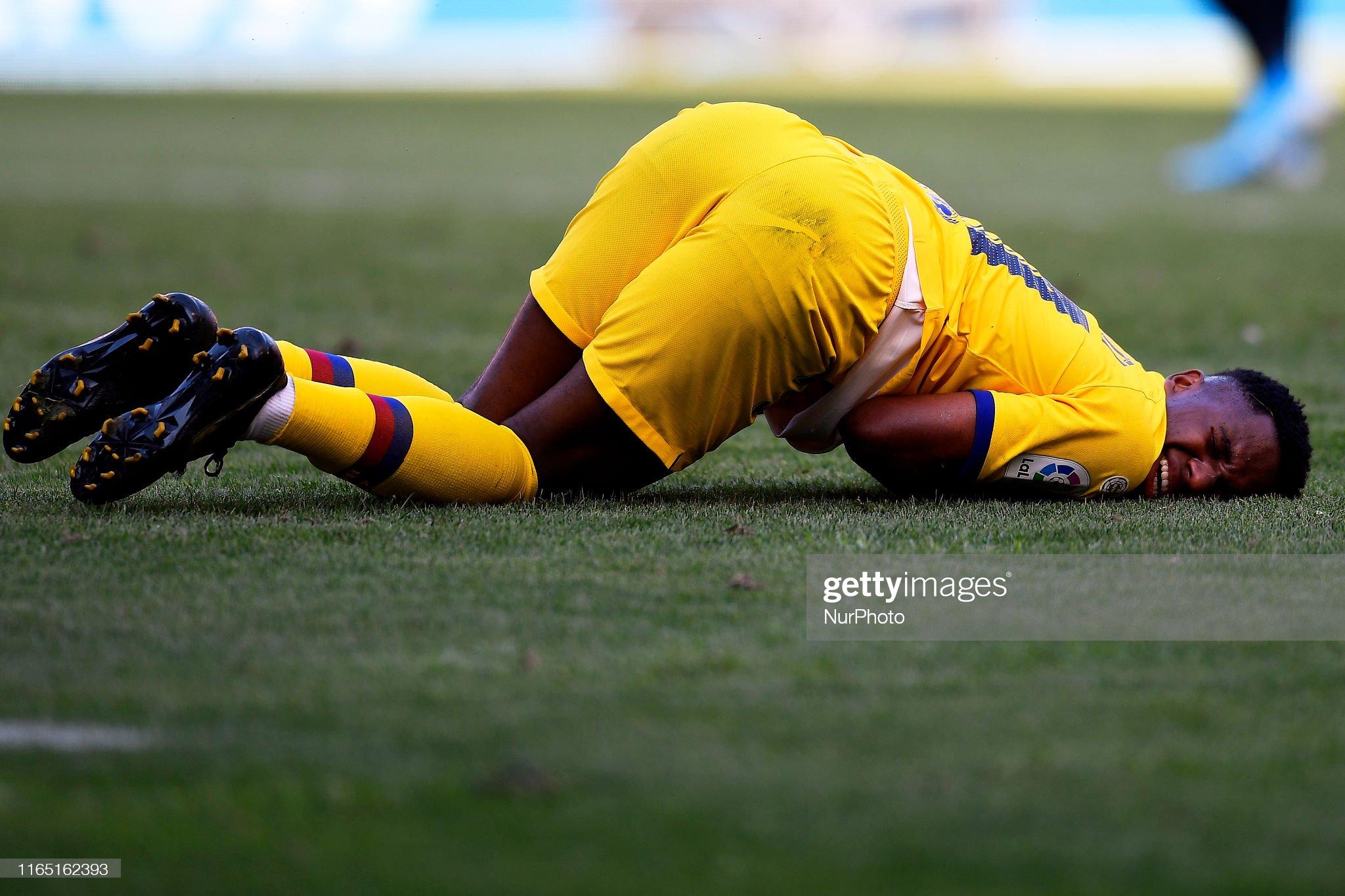 صور مباراة : أوساسونا - برشلونة 2-2 ( 31-08-2019 )  Ansu-fati-of-barcelona-lies-injured-on-the-pitch-during-the-liga-ca-picture-id1165162393?s=2048x2048
