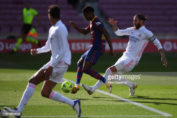 Ansu Fati of Barcelona scores his team's first goal during the La Liga Santander match between FC Barcelona and Real Madrid at Camp Nou on October...