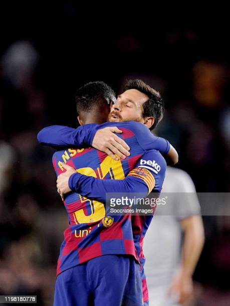 Ansu Fati of FC Barcelona celebrates 1-0 with Lionel Messi of FC Barcelona during the La Liga Santander match between FC Barcelona v Levante at the...