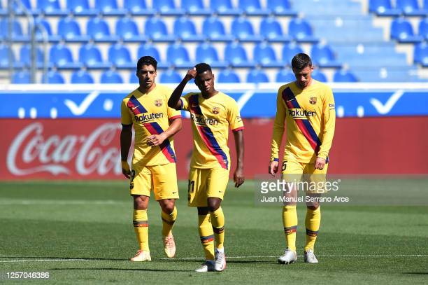 Ansu Fati of FC Barcelona celebrates amongst his teammates Luis Suarez and Clement Lenglet after scoring his sides first goal during the Liga match...