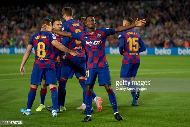 Ansu Fati of FC Barcelona celebrates scoring his team's first goal with teammates during the La Liga match between FC Barcelona and Valencia CF at...