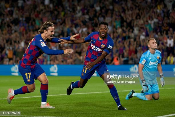 Ansu Fati of FC Barcelona celebrates scoring with teammate Antoine Griezmann their team's first goal during the La Liga match between FC Barcelona...