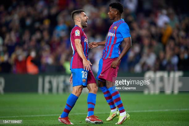 Ansu Fati of FC Barcelona celebrates with his teammate Jordi Alba after scoring their team's first goal during the LaLiga Santander match between FC...