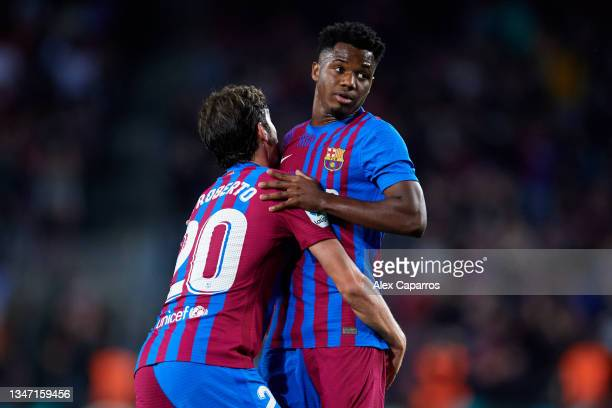 Ansu Fati of FC Barcelona celebrates with his teammate Sergi Roberto after scoring their team's first goal during the LaLiga Santander match between...