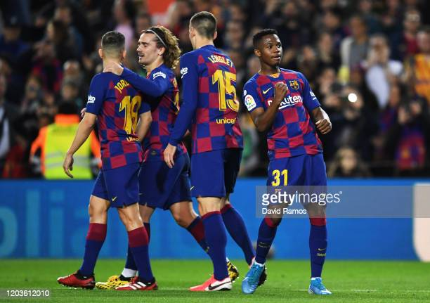 Ansu Fati of FC Barcelona celebrates with his teammates after scoring his sides first goal during the Liga match between FC Barcelona and Levante UD...